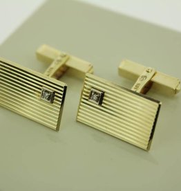 14 carat gold cufflinks with small single cut diamond