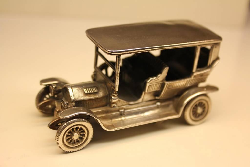 Silver miniature historic car