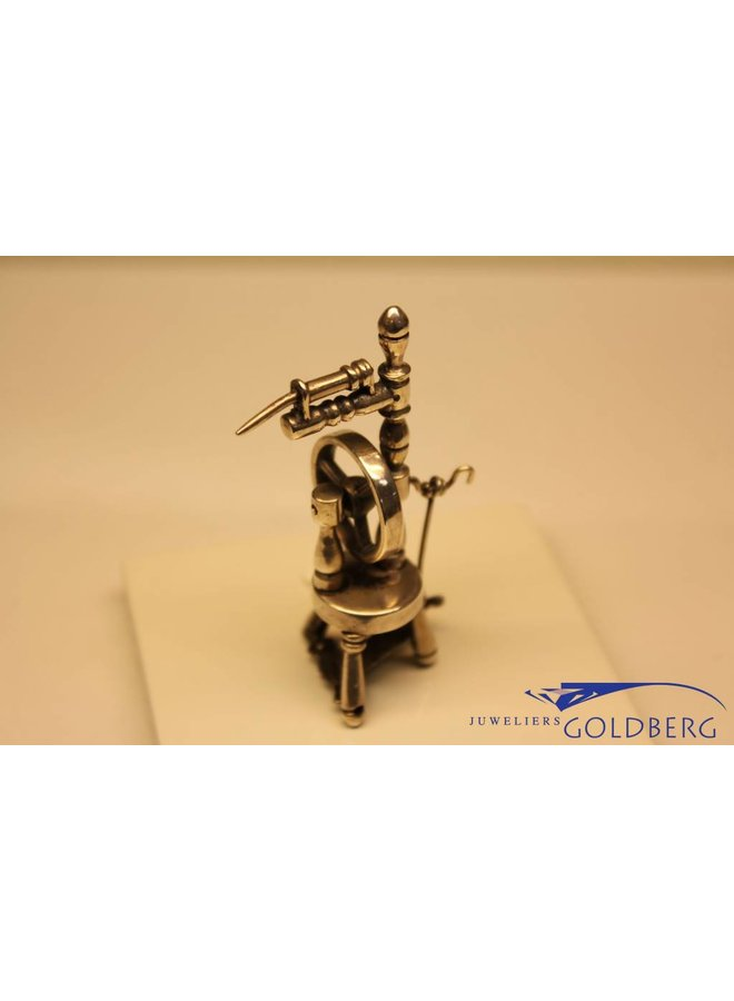 Silver spinning wheel miniature
