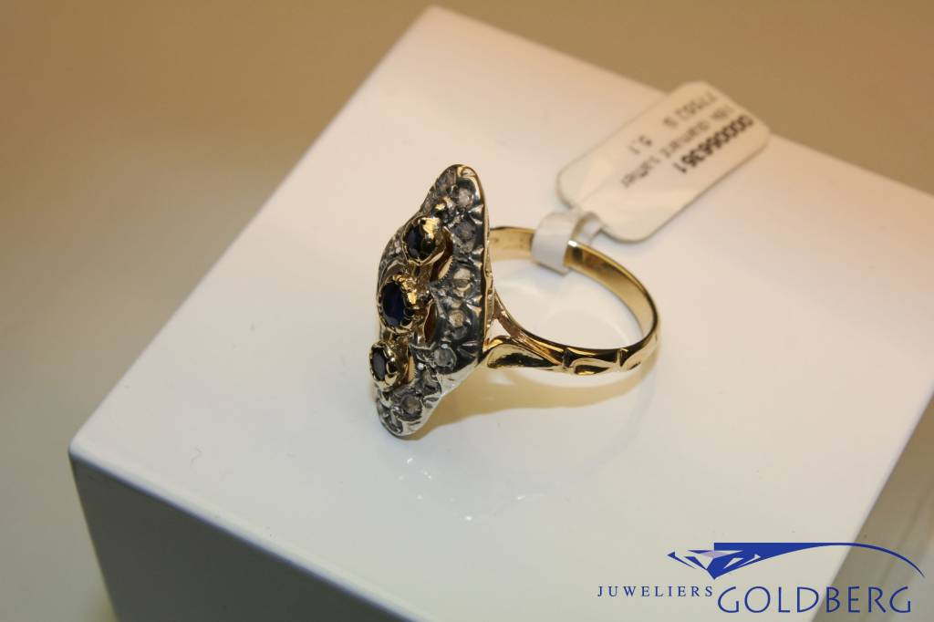 18 carat gold ring with diamond and sapphire