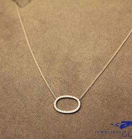 white gold mini necklace with diamond set oval pendant