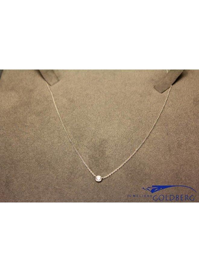 white gold mini necklace with 0.06ct brilliant cut diamond