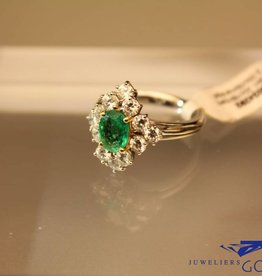 white gold ring oval cut emerald and brilliant cut diamonds