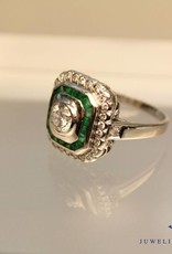 white gold square ring with emeralds and diamands