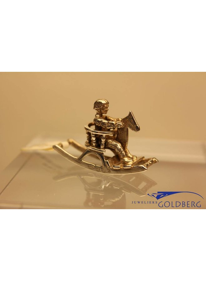 Silver miniature rocking horse with child