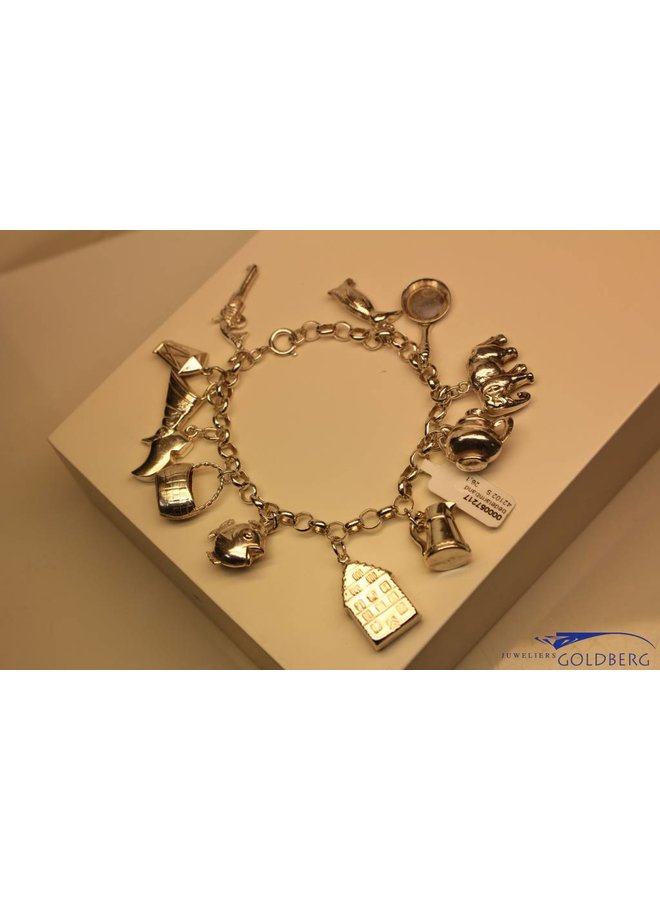 Silver charm bracelet with 12 charms