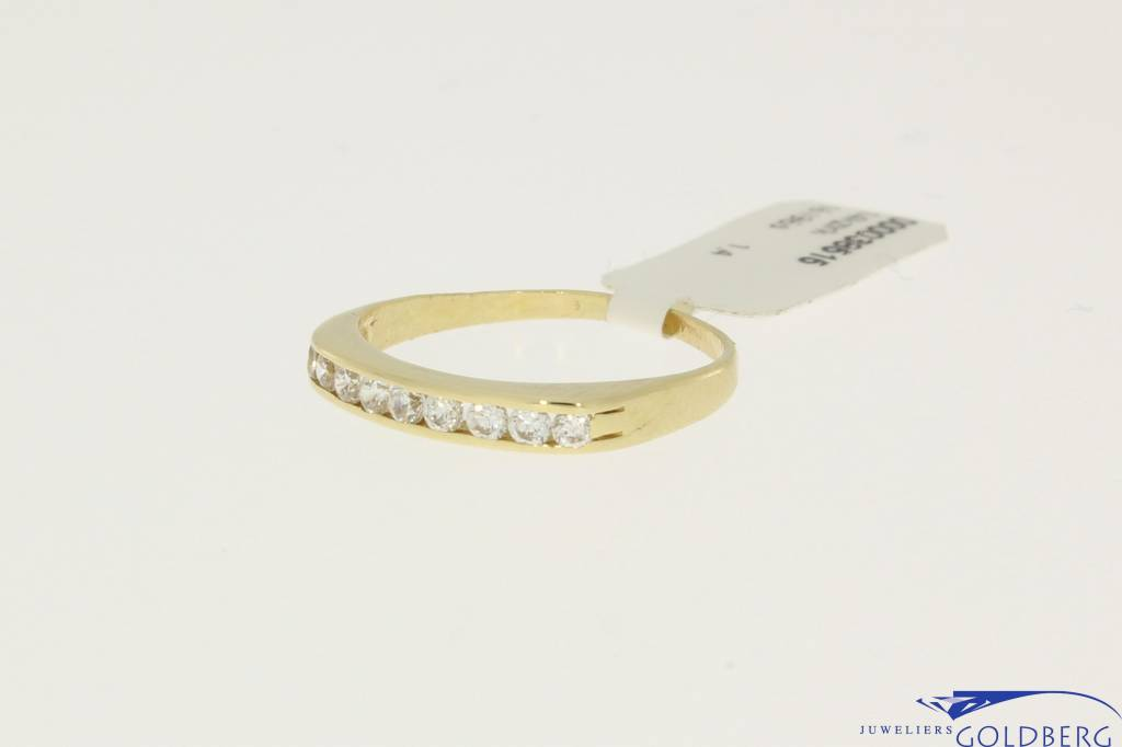 Vintage 14 carat gold ring with zirconia's in rail setting