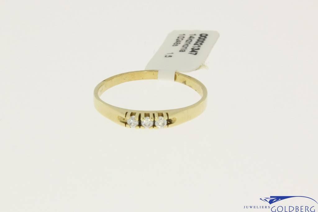 vintage mini gold alliance ring with three zirconia's.